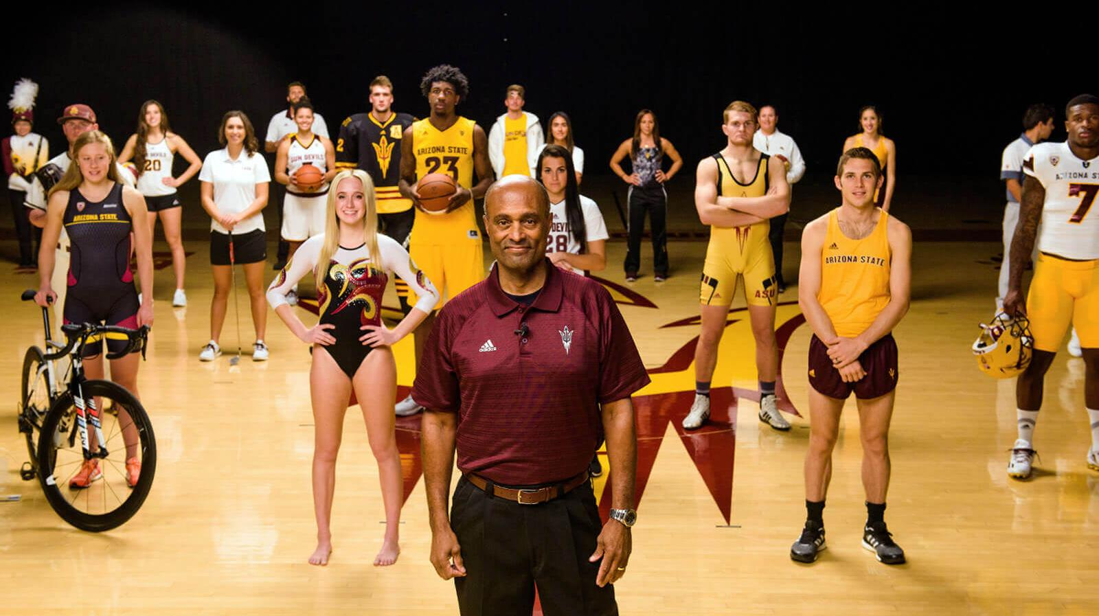 A variety of student athletes from different sports with a coach