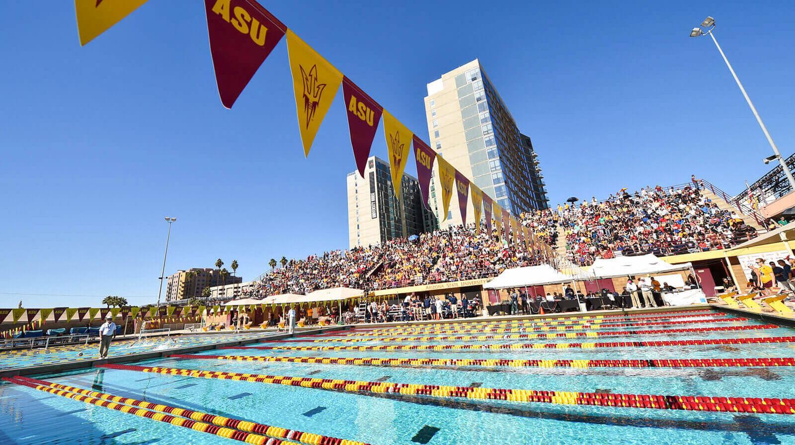 Celebratory ASU flags hang over the pool at Plummer Aquatic Center